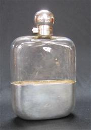 Sale 8298 - Lot 95 - An Edwardian silverplate and crystal hip flask, retailed by Barraclough and Sons, Leeds. Ht: 16cm.