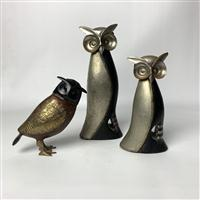 Sale 8725A - Lot 9 - A pair of decorative stylised timber and  white metal owls by Nicholas Fenton together with another in brass effect. Tallest: 30cm