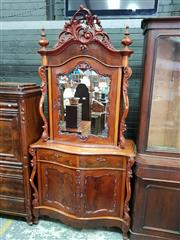 Sale 8728 - Lot 1055 - Late 19th Century Dutch Mahogany Cabinet, with carved crest & mirrored door, enclosing shelves and small drawers, above two drawers...