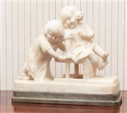 Sale 8881H - Lot 38 - A charming antique French study in marble of two girls at play, one seated on an overturned chair whilst the other pushes it along t...
