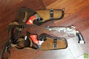 Sale 8365 - Lot 80 - Vintage Cap Guns In Suede Holsters with A Third Pistol