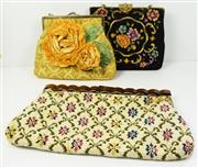 Sale 8460F - Lot 77 - Three vintage embroidered tapestry style bags in yellow, black and cream, larger piece missing to handle, largest W 30cm