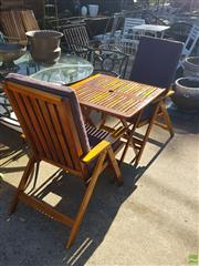Sale 8566 - Lot 1458 - Three Piece Stained Outdoor Setting inc Folding Chairs and Table