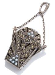 Sale 8954 - Lot 361 - A SILVER EGYPTIAN INFLUENCED CASKET PENDANT; hinged lid and panels set with marcasites and seed pearls on a short anchor link chain...