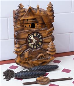Sale 9190H - Lot 402 - A wooden Cuckoo clock. 27x15cm (untested)
