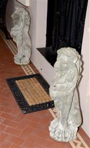 Sale 8107B - Lot 1 - A pair of reconstituted stone seated lions garden figures