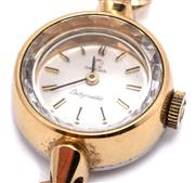 Sale 9090J - Lot 364 - A VINTAGE OMEGA LADYS AUTOMATIC WRISTWATCH, Ladymatic with sunburst dial, baton markers, gold plated case diam. 17mm, plated band,...