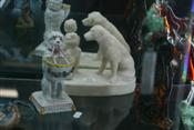 Sale 7875 - Lot 11 - German Porcelain Figure of a Dog with Basket & a Stone Figure Group of a Girl & Dog