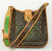 Sale 8460F - Lot 1 - A Louis Vuitton messenger bag with green leather interior classic monogram to bag with pierced design, gilt hardware including lock...