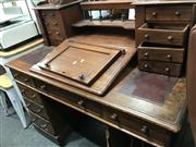Sale 8868 - Lot 1072 - Victorian Mahogany Dickens Style Desk, with gallery back and eight trinket drawers, burgundy writing surfaces & eight drawers below...