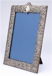 Sale 8960J - Lot 57 - A large antique English hallmarked sterling silver photo frame, Henry Mathews, Birmingham 1897, the frame with elaborate embossed fl...