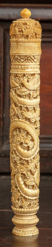 Sale 8976H - Lot 12 - A 19th Century chinese export carved probably ivory needle case, pierced with swirling dragon including needles. height 15cm