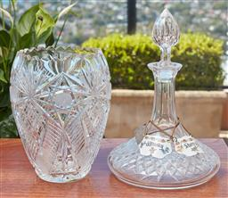 Sale 9099 - Lot 276 - A Waterford crystal decanter, small chip to lid, Height 26cm, wih spirit labels, together with a lead crystal vase, Height 20cm