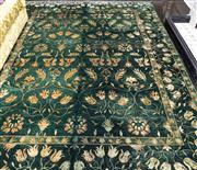 Sale 8298 - Lot 30 - A Large Green Afghan Chobi rug with Tulip Design 240 x 320cm