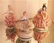 Sale 8430 - Lot 40 - A Dresden crinoline figure in dance pose, together with two others. Height 16cm.