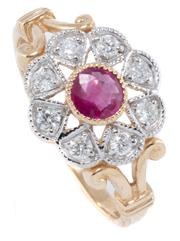 Sale 8946 - Lot 396 - AN EDWARDIAN STYLE RUBY AND DIAMOND CLUSTER RING; set in 9ct gold with central round cut treated ruby to surround of 8 round brillia...