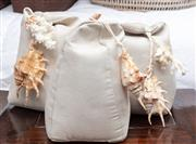 Sale 9023H - Lot 66 - Four small suede doorstops with shells to top