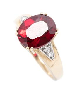 Sale 9253J - Lot 379 - A 9CT GOLD DIAMOND AND SYNTHETIC RUBY RING; double claw set with an oval cut synthetic ruby to shoulders set with 4 round brilliant...