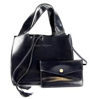 Sale 8134B - Lot 302 - A SALVATORE FERRAGAMO LEATHER BAG WITH POUCH; with internal tag BV-215221, width 27cm.