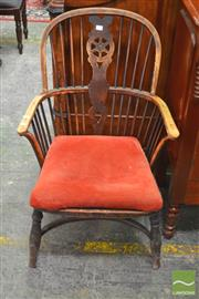 Sale 8282 - Lot 1073 - 19th Century Elm Windsor Armchair, with wheel back splat, modified seat to take a drop in seat (drilled venting holes), on crinoline...