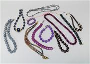 Sale 8740F - Lot 163 - An assortment of beaded jewellery with examples of necklaces in blues, purples and browns, longest 40cm