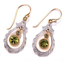 Sale 9253J - Lot 364 - A PAIR OF 9CT GOLD PERIDOT AND DIAMOND EARRINGS; pendulous drop frames each set with 3 round brilliant cut diamonds centring articul...