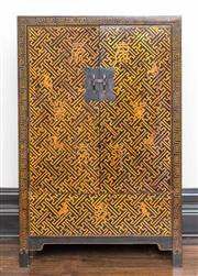 Sale 8222 - Lot 33 - An Oriental black and gilt lacquered two door cabinet, Greek key design, H 160, W 104, D 47