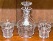 Sale 8308A - Lot 178 - An English Stuart grape and vine etched lead crystal decanter with a pair of matching whisky glasses. Decanter Ht: 22cm