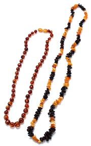 Sale 9083 - Lot 316 - TWO GRADUATED AMBER BEAD NECKLACES; one a 6-12mm tumbled amber bead necklace in bands of honey and dark cherry colours, length 68cm,...