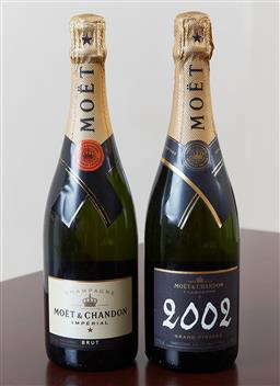 Sale 9120K - Lot 72 - Two bottles of Moet champagne, one 2002 Grand Vintage, the other an Imperial.