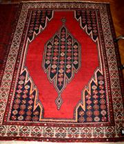 Sale 8080A - Lot 70 - A Maslagan wool carpet with red field and chains of flowers.