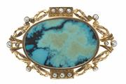 Sale 8442 - Lot 354 - A TURQUOISE AND PEARL BROOCH; 9ct gold vintage oval frame set with seed pearls, centring a later polished turquoise plaque, 52 x 35m...