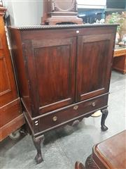 Sale 8714 - Lot 1100 - Georgian style Mahogany Cabinet on Stand, with panel doors, long drawer & shell carved apron, raised on cabriole legs