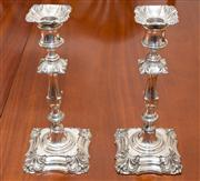 Sale 8308A - Lot 90 - A pair of Victorian silverplate candlesticks with removable wax drip pans. Elkington Mason & Co., England C: 1842 - 1864. Ht: 25cm