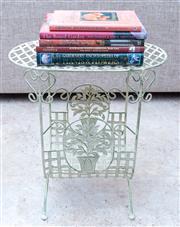 Sale 8489A - Lot 29 - A small iron work shabby chic magazine rack/table with floral design, together with a small quantity of gardening books, H 54cm
