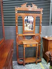 Sale 8617 - Lot 1015 - Late Victorian Carved Walnut Hallstand, the mirror back mounted with brass & ceramic hooks, a drawer below & turned legs
