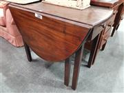 Sale 8744 - Lot 1075 - Mahogany Drop Leaf Dining Table