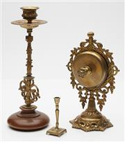 Sale 9080W - Lot 44 - A French brass wind up table bell together with a brass and timber candlestick and a miniature example. Height of tallest 24cm