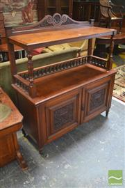Sale 8282 - Lot 1086 - Late Victorian Walnut Dumbwaiter, with two tiers, turned gallery & two carved panel doors (slight cracks)