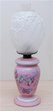 Sale 8430 - Lot 43 - A milk and pink glass kerosene lamp painted with grapes and a frosted shade