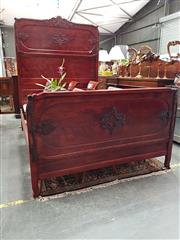 Sale 8693 - Lot 1010 - Victorian Style Possibly Cherrywood Stained Mahogany Double Bed, the high back with scroll & rope style carvings & conforming footboard