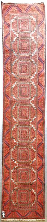 Sale 8956 - Lot 1049 - A Turkoman Wool Runner with repeating Octagons in deep orange and red tones (340 x 72cm)