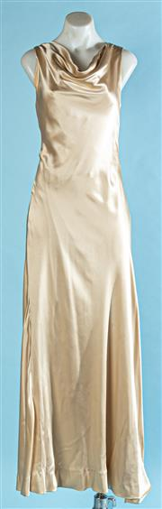 Sale 9090F - Lot 42 - A VINTAGE BACKLESS FLOOR LENGTH EVENING GOWN, in gold silk with cowl neck size S