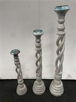 Sale 9102 - Lot 1124 - Set of 3 Graduating Turned Timber Candle Holders (largest h:101cm)