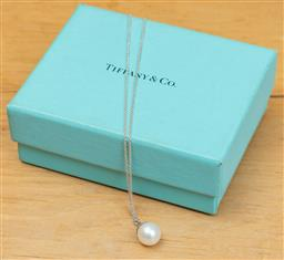 Sale 9165H - Lot 108 - Tiffany and Co Sterling Silver chain and pearl pendant, Chain Length 42 cm in original box.