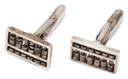 Sale 9186 - Lot 384 - A PAIR OF SILVER ABACUS CUFFLINKS; each an 18 x 12mm abacus to folding bar backs, wt. 9.90g.