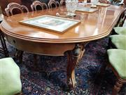 Sale 8728 - Lot 1037 - Unusual Victorian Carved Mahogany Extension Dining Table, with D shaped ends & four Leaves, on carved cabriole legs (alterations/...