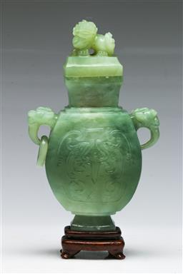 Sale 9138 - Lot 107 - A Carved Chinese Greenstone Censor (H:21cm) Decorated With Twin Elephant Handles and Foo Dog Finial
