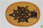 Sale 8520T - Lot 147 - Oval Shaped Plaque with Carved Coconut Shell Tree Form Motif