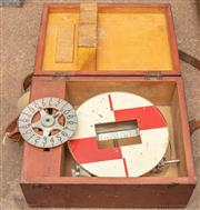 Sale 8984W - Lot 540 - A surveying measure and wheel in a fitted case width 28cm